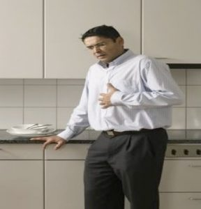Adult experiencing chest pain after eating