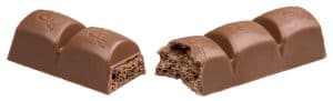 Chocolate contains cocoa and sugar, both might cause chest pain.